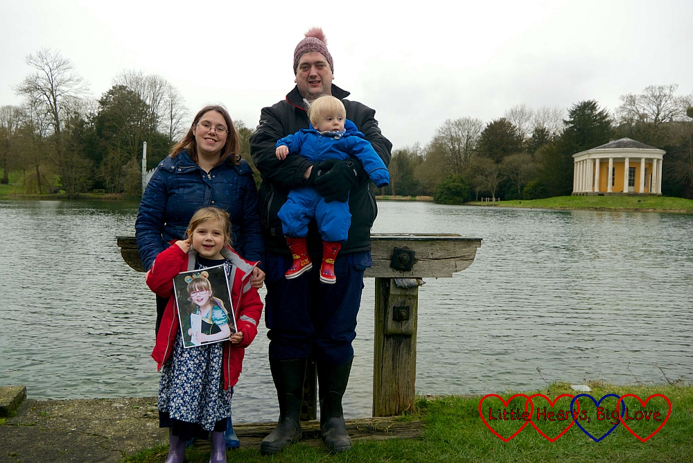Me, Sophie (holding a photo of Jessica), hubby and Thomas in front of the lake at West Wycombe Park