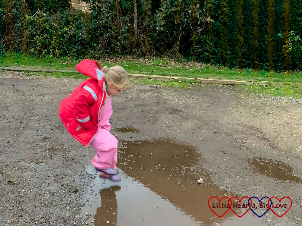 Sophie jumping into a big puddle