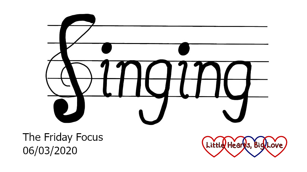 The word 'singing' written on a musical stave with the 'S' forming part of a treble clef
