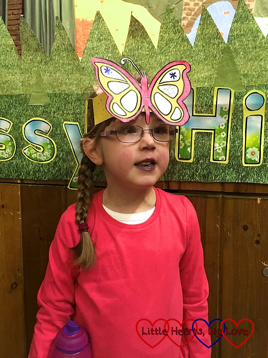Jessica wearing a pink top and a butterfly head-piece at the end of her Year 1 performance