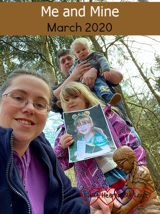 "A selfie of me, Sophie (holding a picture of Jessica) and hubby holding Thomas at Jessica's forever bed with her carving in the foreground - ""Me and Mine - March 2020"""