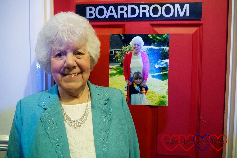 My mum standing next to the photo of her and Jessica on the wall at her 80th birthday party
