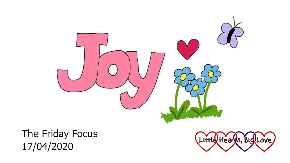 The word 'joy' in pink with doodles of a red heart, blue forget-me-nots and a lilac butterfly