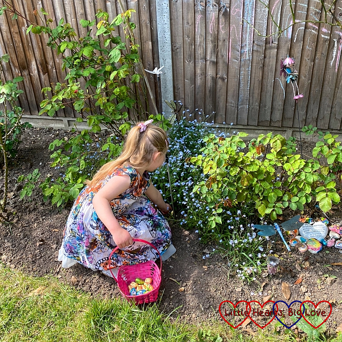 Sophie hunting for Easter eggs amongst the forget-me-nots in the garden