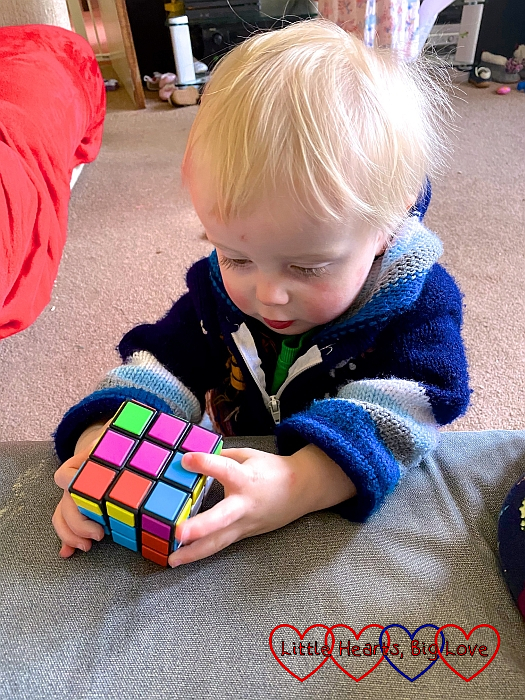 Thomas playing with a Rubix cube