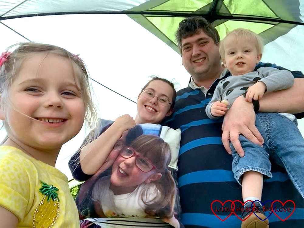 Sophie, me (holding a cushion with Jessica's photo on) and Daddy holding Thomas in our event shelter in the garden