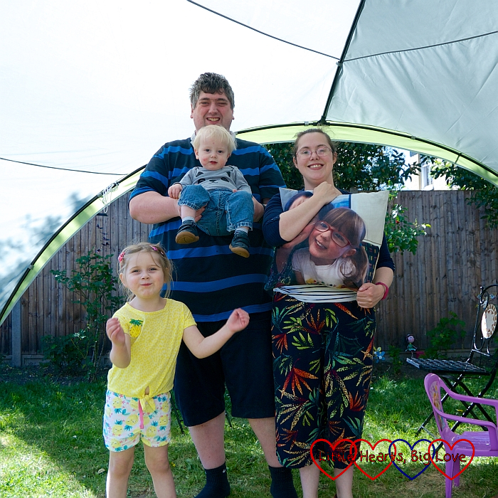 Sophie, Daddy (holding Thomas) and me holding a photo of Jessica in our event shelter in the garden