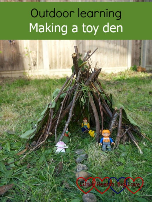 "A toy den made of sticks with Playmobil 123 and Duplo figures inside - ""Outdoor learning: Making a toy den"""