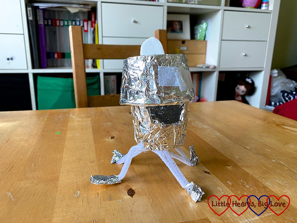 The finished lunar module made from a polystyrene cup,tin foil and pipe cleaners