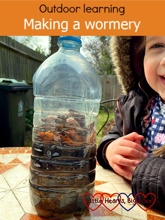 "A wormery made from a plastic bottle with alternating layers of sharp sand and compost inside - ""Outdoor learning: making a wormery"""