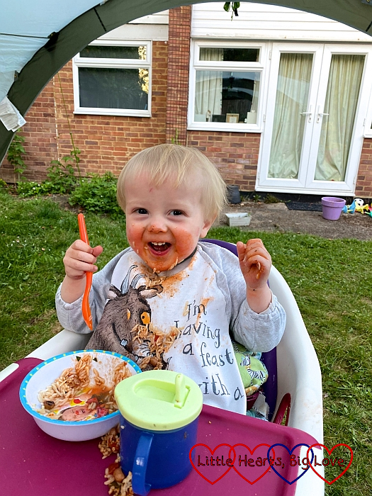 Thomas eating dinner in the garden (with most of it smeared around his face!)