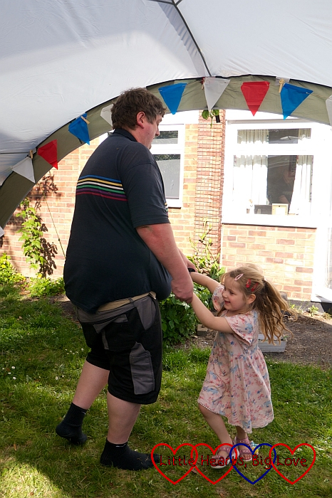 Sophie dancing with Daddy in the garden