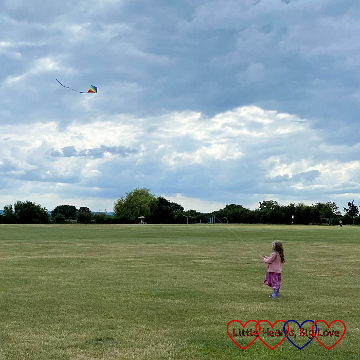Sophie flying a kite at the park
