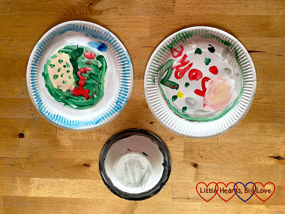 Two painted paper plates and a painted paper bowl