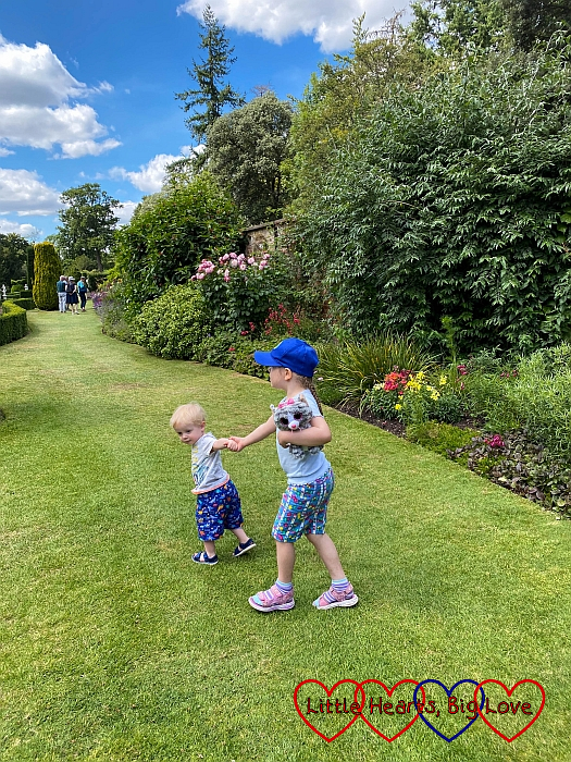Thomas pulling Sophie on through the Long Garden at Cliveden