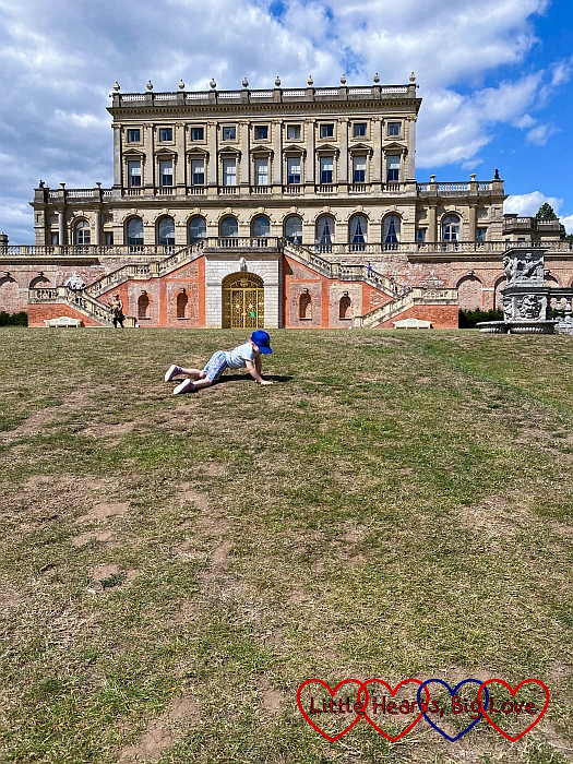 Sophie rolling down the hill at the back of the house at Cliveden