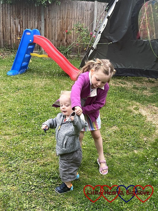 Sophie dancing with Thomas in the garden