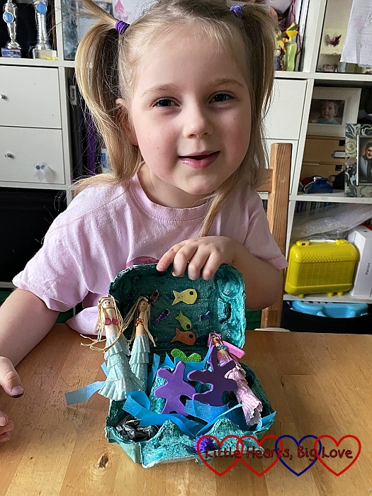 SOphie with her ocean in an egg carton