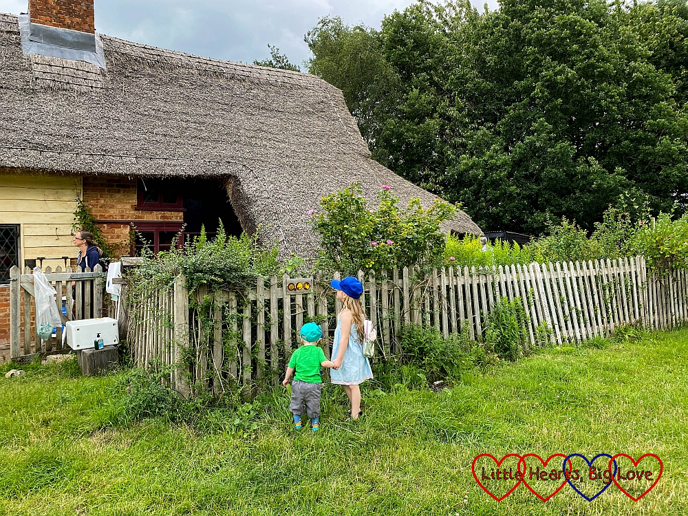 Sophie and Thomas outside a thatched cottage at Chiltern Open Air Museum