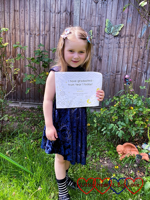 """Sophie with her """"I graduated from Year 1 today' certificate"""