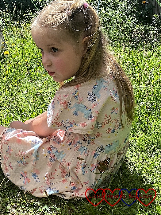 Sophie with a butterfly on the back of her dress