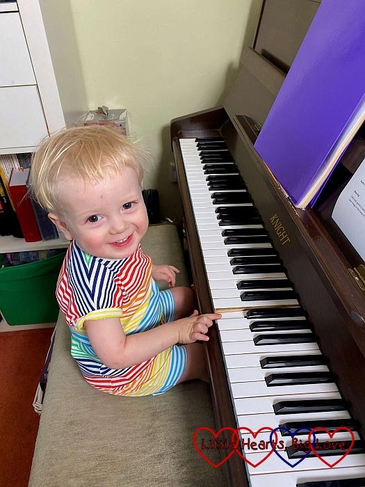 Thomas sitting at the piano