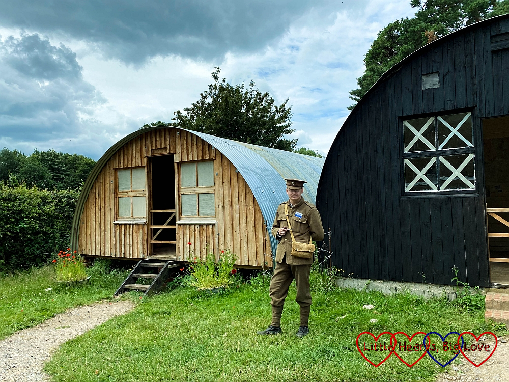 A WW1 soldier outside the WW1 Bow Hut and Nissen Hut