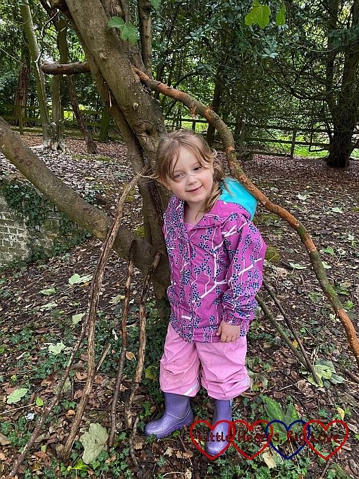 Sophie standing inside the beginnings of her den