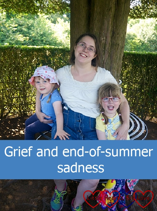 "Me sitting on a bench in front of a tree with my girls either side of me - ""Grief and end-of-summer sadness"""