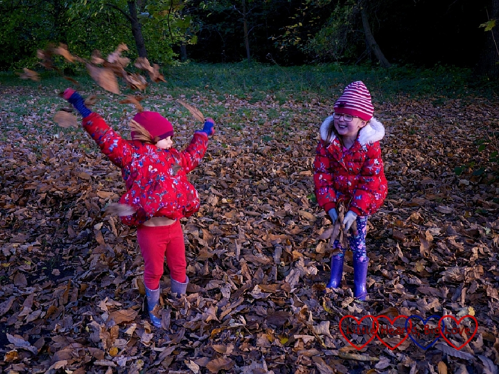 Jessica laughing at Sophie throwing autumn leaves into the air