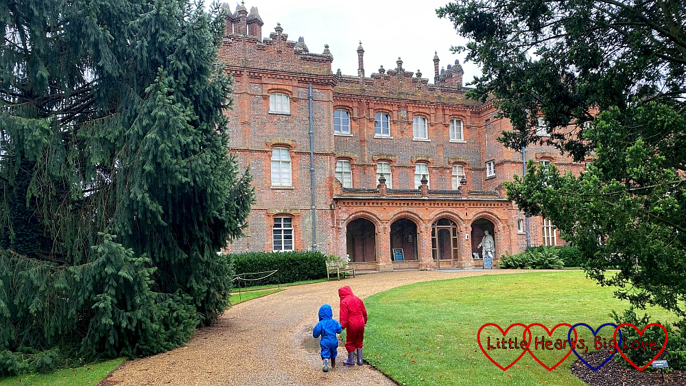 Sophie and Thomas walking towards the house at Hughenden