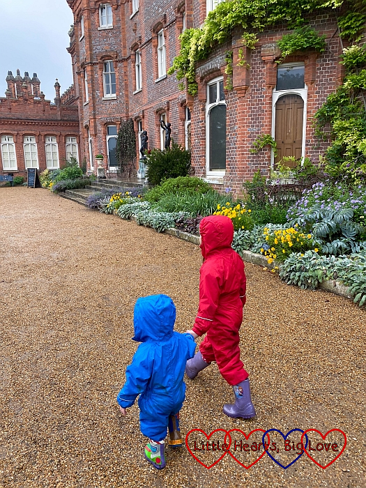 Sophie and Thomas walking around the back of the house at Hughenden