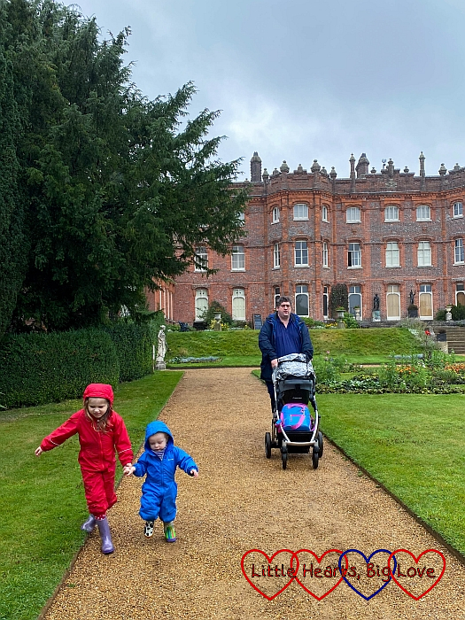 Sophie, Thomas and Daddy walking through the gardens at the back of Hughenden