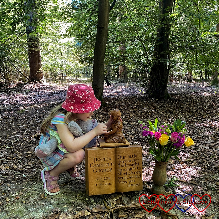 Sophie talking to the wooden carving of Jessica at Jessica's forever bed