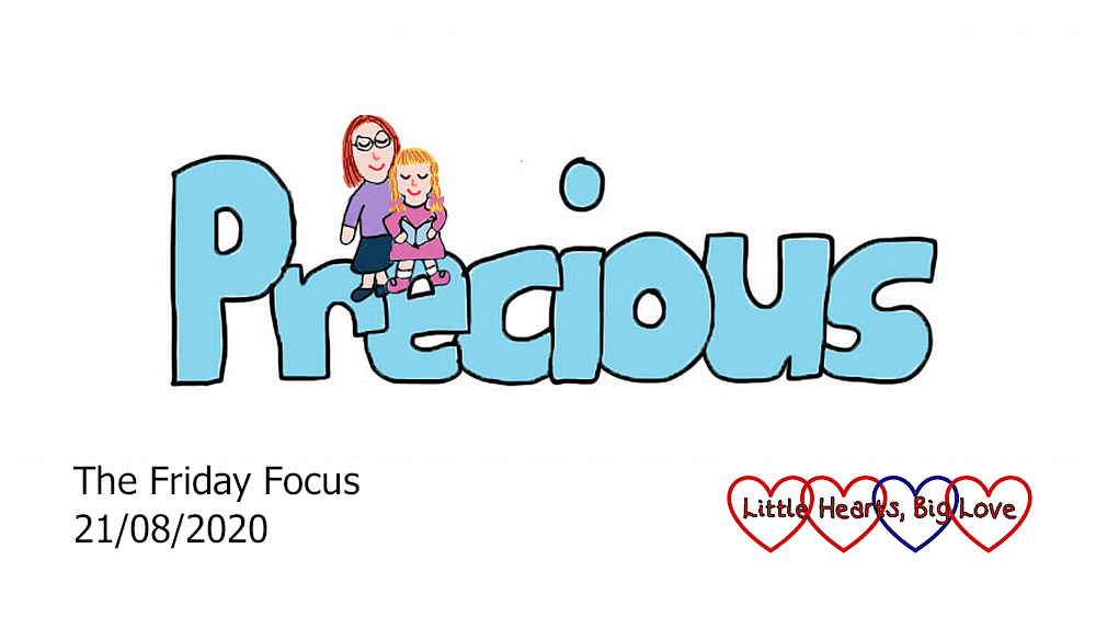 The word 'precious' with a drawing of me and Sophie reading a book and sitting on the 're'