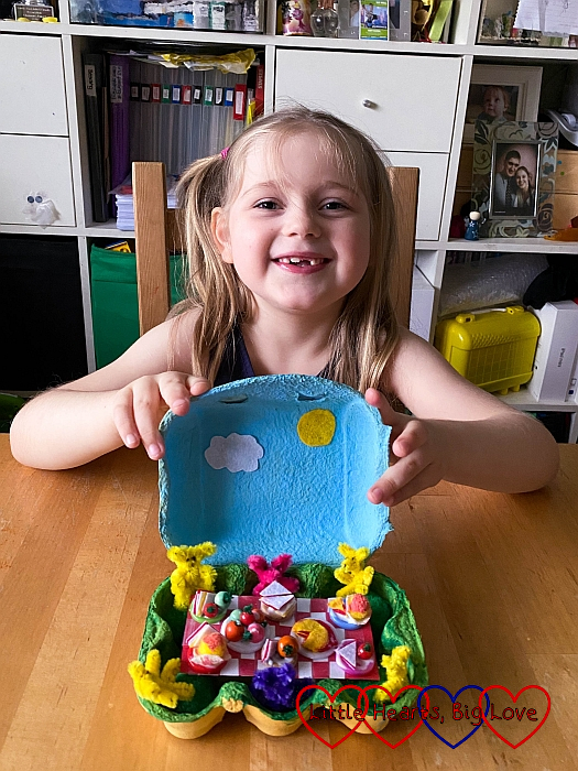Sophie with her teddy bears' picnic in an eggbox