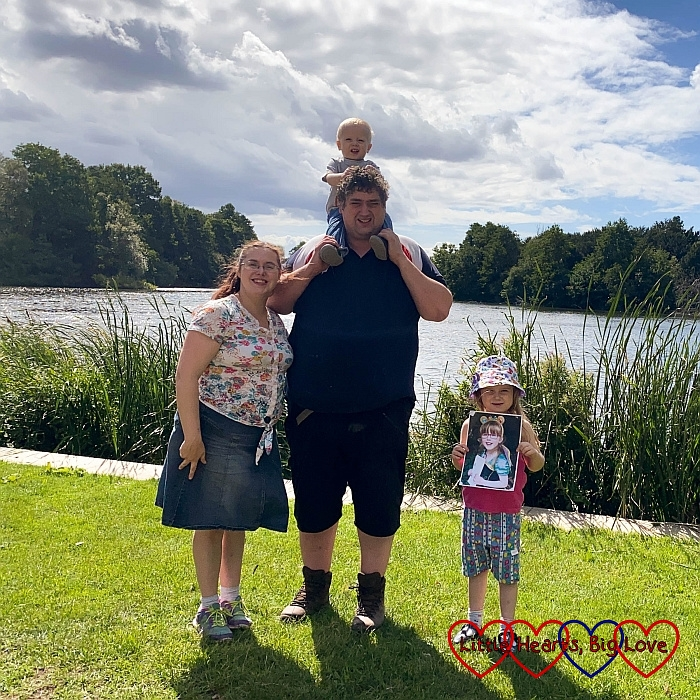 Me, hubby (with Thomas on his shoulders) and Sophie (holding a photo of Jessica) in front of the lake at Osterley Park