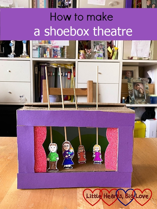 """A shoebox theatre with cartoon figures of me holding Thomas, hubby, Jessica and Sophie stuck to wooden skewers - """"How to make a shoebox theatre"""""""