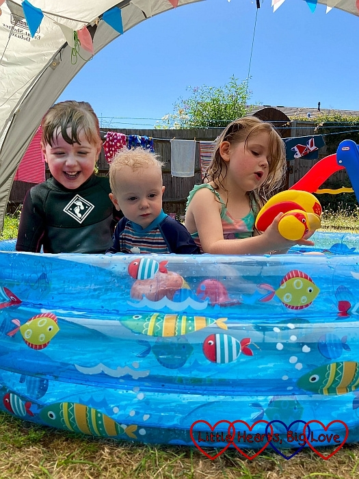 Jessica, Thomas and Sophie in the paddling pool together