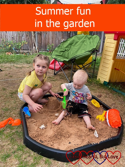 """Thomas and Sophie playing with sand in the tuff tray - """"Summer fun in the garden"""""""