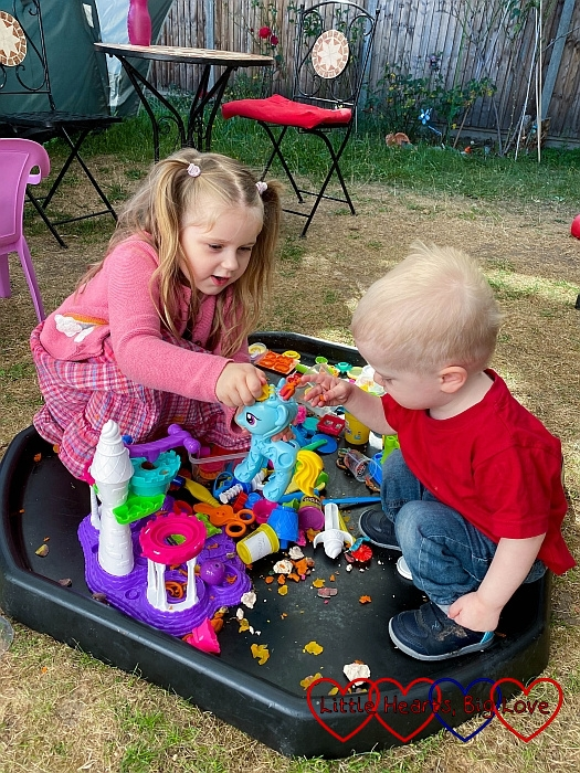 Sophie and Thomas playing with playdoh in the tuff tray