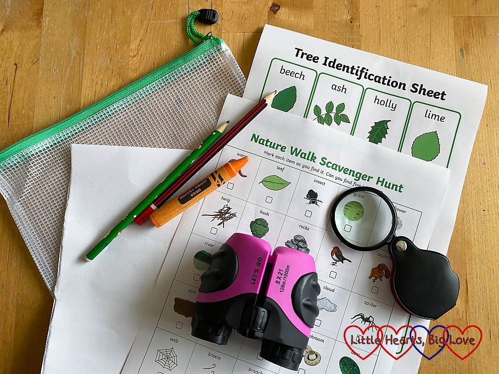 A scavenger hunt sheet, binoculars, magnifying glass, pencil, crayon and plastic zip-up pouch