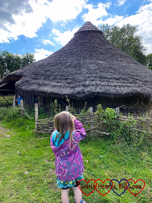 Sophie taking a photo of the Iron Age house