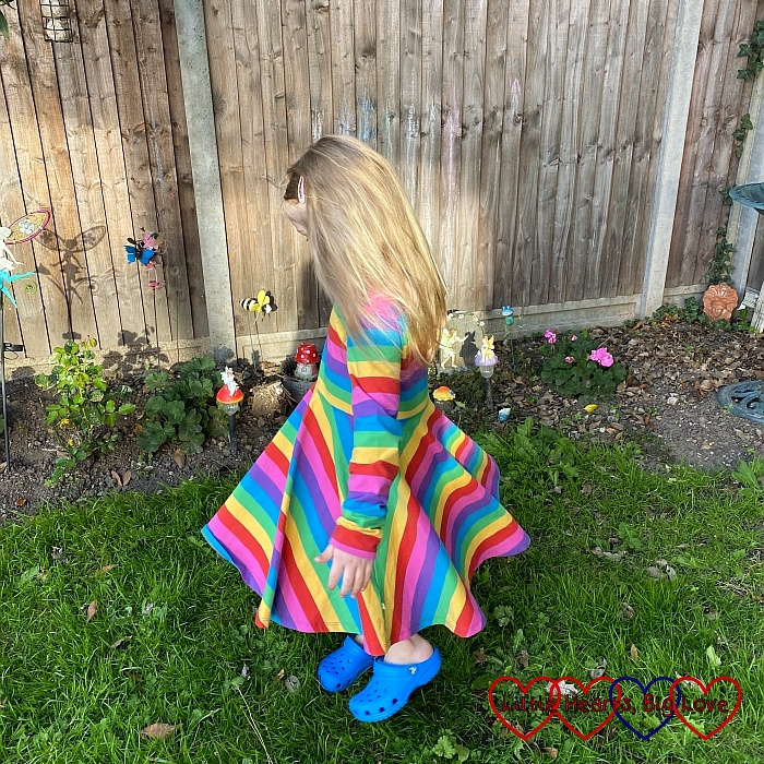 Sophie twirling in her rainbow dress