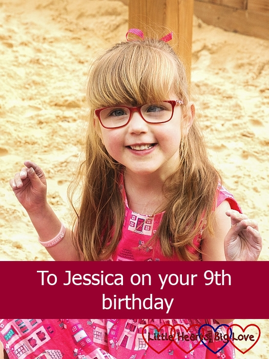 "A smiley Jessica sitting in a sand pit - ""To Jessica on your 9th birthday"""