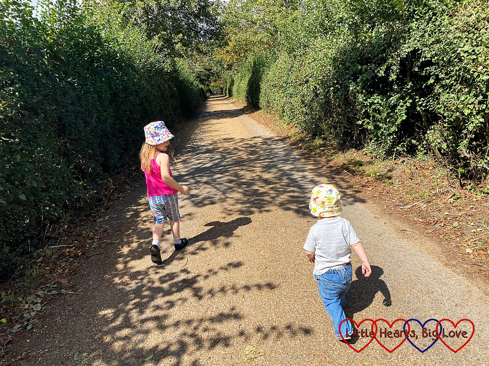Sophie and Thomas walking along a path at Osterley Park
