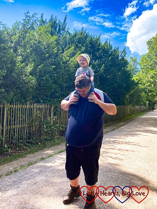 Thomas riding on Daddy's shoulders