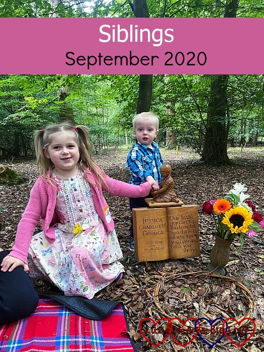 """Sophie and Thomas with the wooden carving of Jessica at Jessica's forever bed - """"Siblings - September 2020"""""""