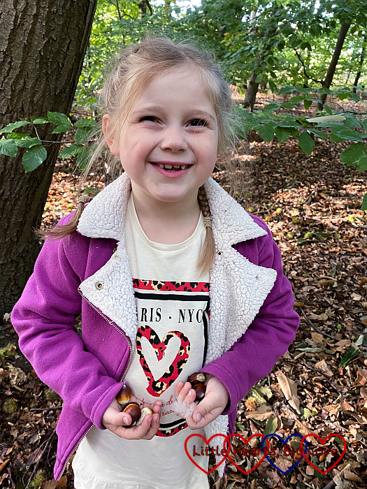 A smiley Sophie with a handful of sweet chestnuts