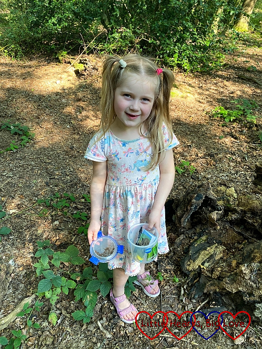 Sophie holding a geocache